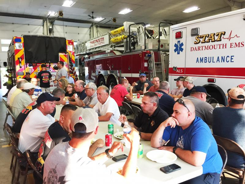 Firefighters eat in the Bridge Street station