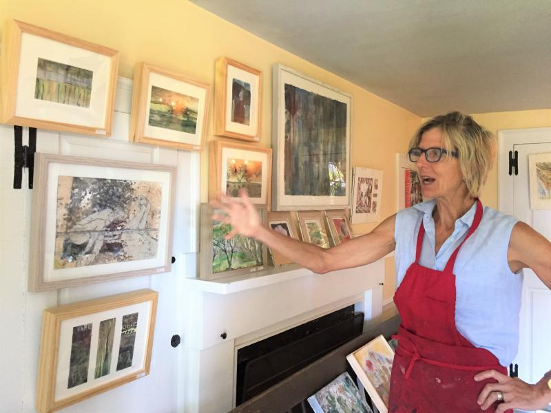Artist Gay Gillies shows her artwork hanging in the original dining room of her historic house