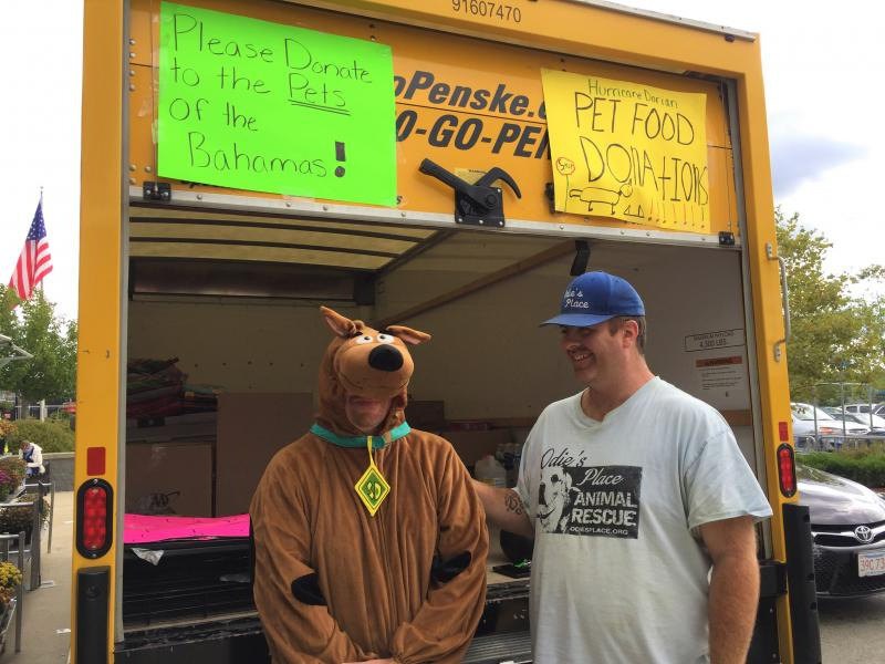 Scooby Doo (Jeff Houghton) and Brian Harrington of Odie's Place Animal Rescue collecting donations from a truck outside Wal-Mart this week. Photo by: Kate Robinson