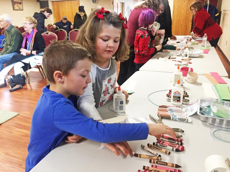 Dartmouth, MA news - Christmas at Southworth Library - Reidar Bendiksen, 4, does crafts with his five-year-old sister Ellery. Photos by: Kate Robinson
