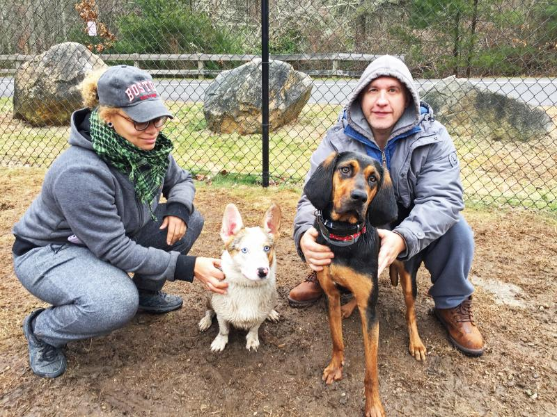 Dartmouth, MA news - Lynne Daencarnacao of Fall River with 11-month-old Remzi next to Chris Bell of New Bedford with his four-month-old coonhound pup Bailey. Photos by: Kate Robinson