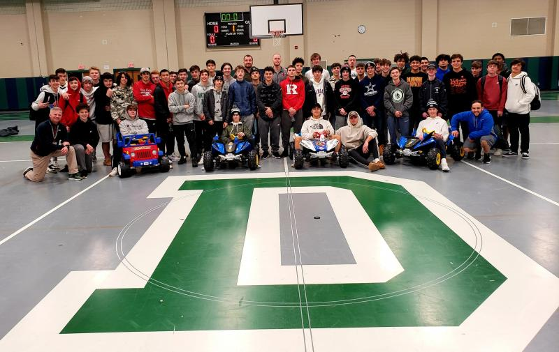 The Dartmouth High boys hockey and basketball teams took part in the community service event as part of their regular practice. Photo courtesy: Friends of Jack Foundation/Facebook
