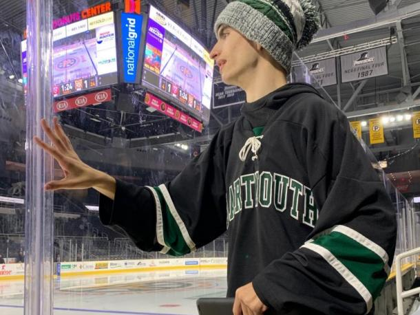 Dartmouth High hockey superfan Liam Amaral watches at the Dunkin' Donuts Center in Providence. Photo by: Kathleen Amaral