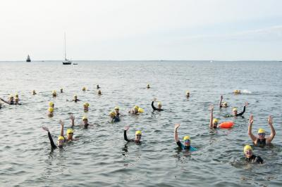 Participants wave at the 2019 Buzzards Bay Swim