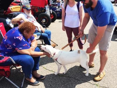 Dolores Faber greets one-year-old pup Luna at the car show