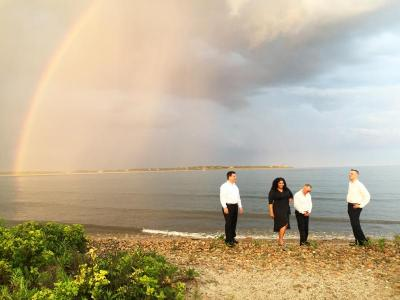 The band, Lucky 13, also took the opportunity to get a photo with the rainbow on the beach