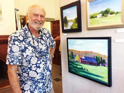 Painter and printmaker Jim Sears next to an oil painting of a farm on Rock O'Dundee Road