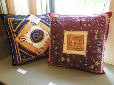 Whimsical quilted pillow collages by Marjorie Durko Puryear on display
