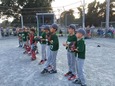 Dartmouth's 9U team line up after winning the game 25-2