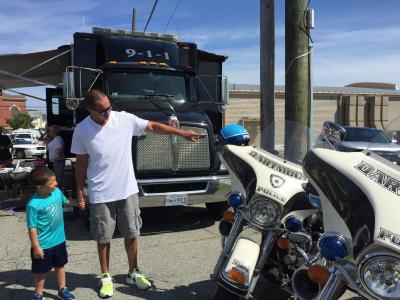 Leyden Leite, 4, admires the Dartmouth Police motorcycles with his father John.