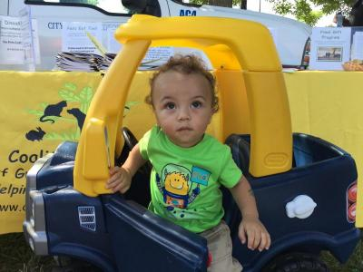 Ja'siyah Lopes, 1, playing in a toy car at the event.