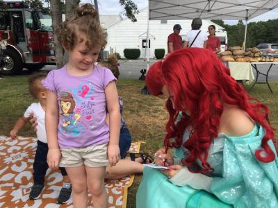 Sophia Morelli, 4, gets an autograph from the princess.