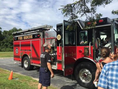 Dartmouth Fire District No. 1 made an appearance with a shiny red fire truck for the kids to explore.