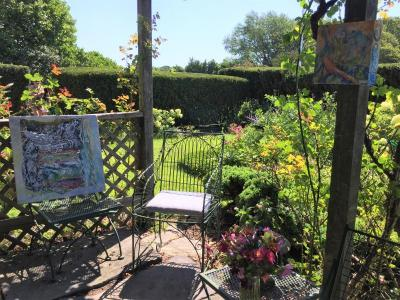 Paintings on Gillies' garden patio during the Art Drive on August 10