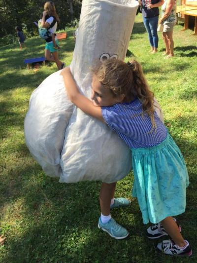Fiona McGrath, 6, hugs her sister Faye, 9, who is dressed as a bulb of garlic.