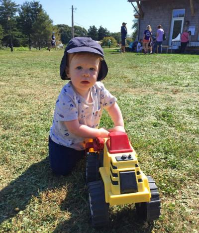 Otis Gerrior, 1, from Swansea, pushes a toy tractor.