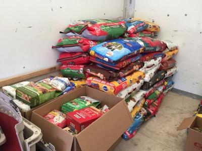 Donated bags of dog and cat food are already piling up in the truck.