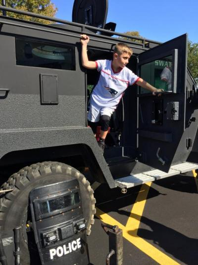 Jaxon Lussier, 7, of Fairhaven climbs out of the S.W.A.T. van before the ceremony.