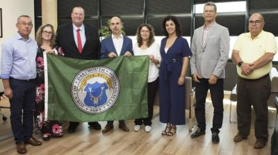 Jorge Cabrita, Louise and Shawn McDonald, President Luis Encarnacao, Vice-President Analbel Simao, and council members holding the Dartmouth flag. Photo courtesy: Shawn McDonald
