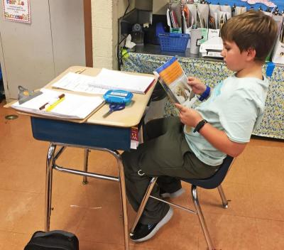 Some students still chose traditional desk seating, as nine-year-old Preston Pereira did.