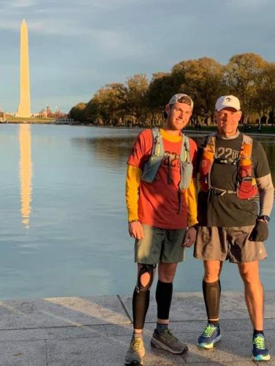 The pair of runners in front of the Washington Monument in D.C. at the very end of their run on November 22. Photo courtesy: Facebook/500 miles to end veteran suicide