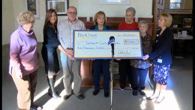 The day before the party, Bay Coast Bank presented the Cultural Center with a check for $5,000. Image courtesy: DCTV