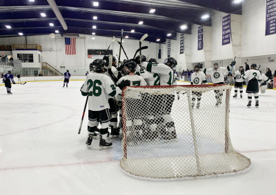Dartmouth High School celebrating their 7-1 win over Martha's Vineyard on March 1. Photo courtesy: Ross Thibault/Twitter