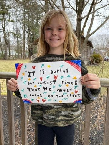 Dartmouth Week - Dartmouth, MA news - Third grader Avery Parker with a quote in a photo posted to the Dartmouth Police Department's Facebook page. Photo courtesy: DPD