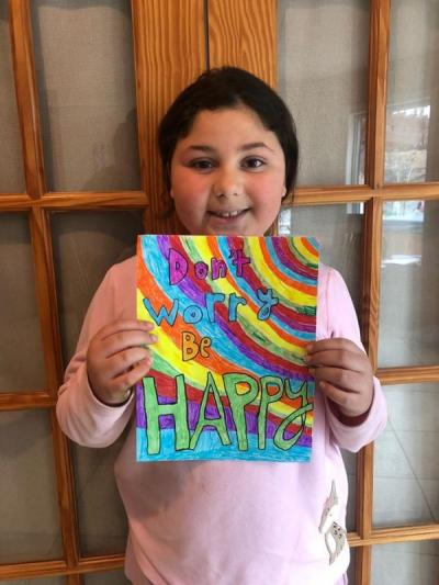 Dartmouth Week - Dartmouth, MA news - Third grader Sophia Medeiros with her quote for the police department's page. Photo courtesy: DPD