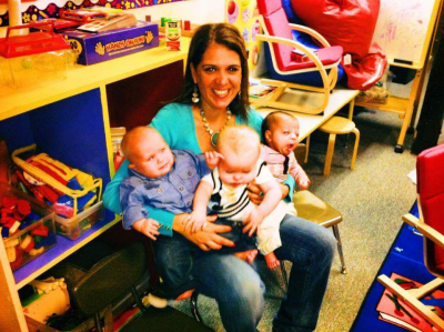 Dartmouth Week - Dartmouth, MA news - Belanger with infants at her daycare center. Photo courtesy: Sally Belanger/Facebook
