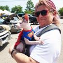 Kate Chellman and her one-year-old Sphinx cat, Cal, enjoy the cars