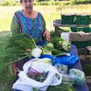 Eileen Paccia shows off the produce from her CSA at Brix Bounty