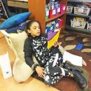 LeeAna Matthews, 8, reclines while reading.