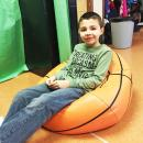Gianni Rogers, 8, on a beanbag chair.