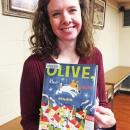 Dartmouth, MA news - Christmas at Southworth Library - Children's Librarian Christie Phillips shows the book she read to the kids: 'Olive, the Other Reindeer'.