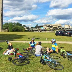 Cyclists rest on the grass at UMass Dartmouth after completing the 100-mile trek. Photos by: Kate Robinson