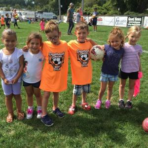 Averie DaCosta, Abby Bussiere, triplets Sam, Dan, and Elsie Castanheira, and Amelia Dias, all five years old, are excited to start playing soccer for their first season. Photo by: Kate Robinson