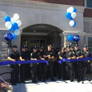 Dartmouth Police Chief Brian Levesque cuts the ribbon in the third ribbon-cutting ceremony to open the new headquarters on Tucker Road. Photos by: Kate Robinson