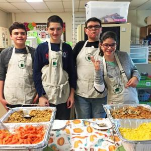 Daniel Howayeck, Austin Santos, Caleb Rapoza, and Alexis Benjamin serve up food at the Dartmouth Middle School PALS/PASS Friendsgiving. Photos by: Kate Robinson