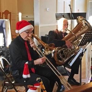Michael Rocha on trombone and Bill Kingsland on tuba with the Buttonwood Brass Trio at the St. Peter's Yuletide Holiday Concert. Photos by: Kate Robinson - Dartmouth, MA news