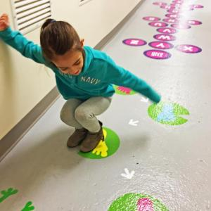 Dartmouth, MA news - Six-year-old Emily Cabral jumps on the new sensory path at Cushman School. Photos by: Kate Robinson