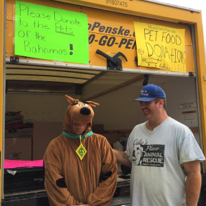 Dartmouth Week - Dartmouth, MA news - Brian Harrington (right) and a friend at an Odie's Place hurricane pet food drive in September 2019. Photo by: Kate Robinson